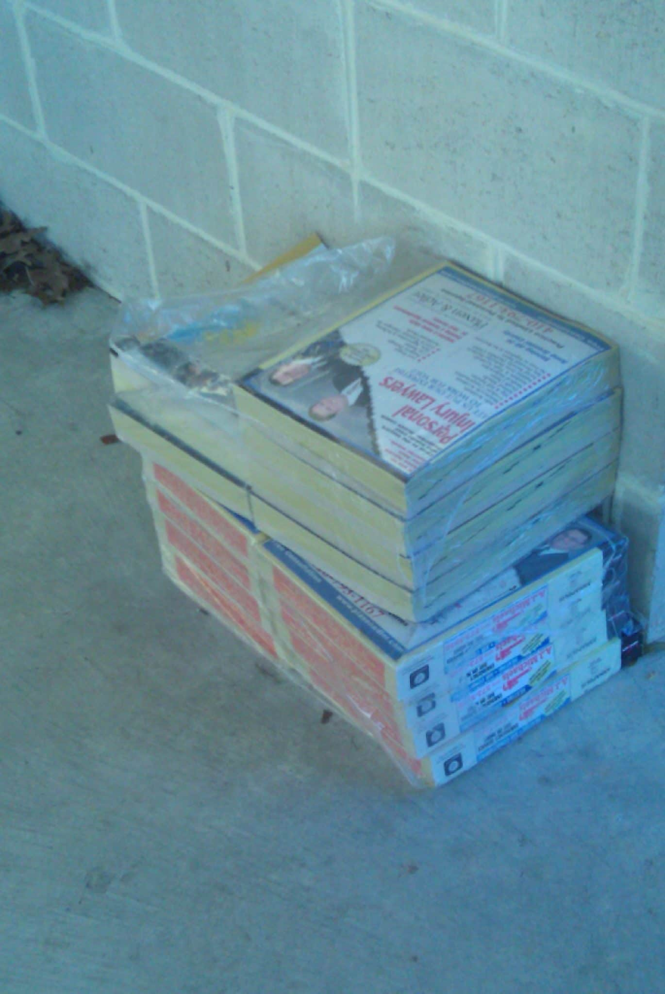 Phonebooks wait to be picked up