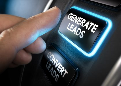 """Hand shown pressing a button that says """"Generate Leads"""""""