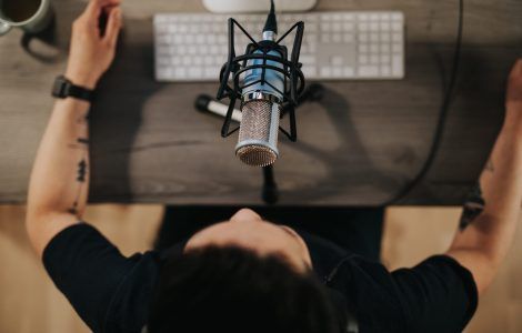 Photo series of a japanese podcaster making video podcast from his home studio.